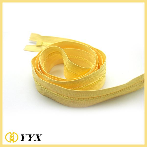 Cheap garment zipper yellow color plastic zippers large roll custom resin zipper