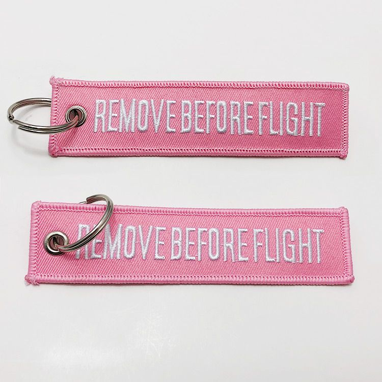 Double sided remove before flight tag custom embroidered keychain